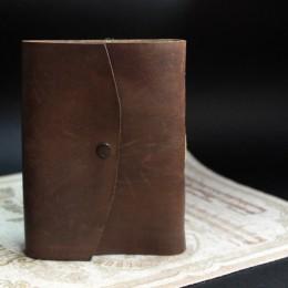 Фото блокнот ручной работы из коричневой кожи