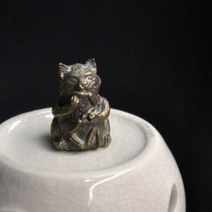 Фото Напёрсток из бронзы Кот с сосисками
