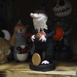 Фото Нюхль в волшебной шляпе и с монетками