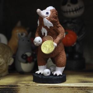 Фото Рыжий нюхль с монетками и жемчугом