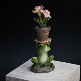 Фото Лягушка с горшком с цветами на голове фигурка